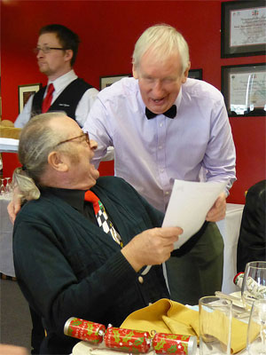 A couple of members enjoying a joke at the 2014 Christmas meal